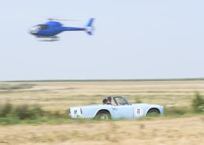 Triumph TR 4 survolée par l'hélico EC 120 colibri lors du rallye historique du touquet paris plage